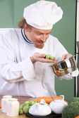 Funny young Chef with Brussels sprouts — Stock Photo