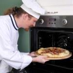 Young chef prepared italian pizza in kitchen — Stock Photo