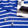 Blue striped sweater and earring — Stock Photo