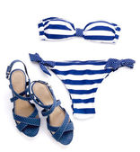 Striped bikini and spotted sandal — Stock Photo