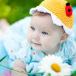 Adorable baby girl outdoors in the grass — Foto de Stock