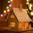 Gingerbread house with lights inside - Stockfoto