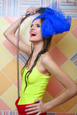 Beautiful happy girl taking shower — Stock Photo
