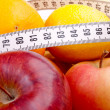 Centimeter and fruits — Stock Photo