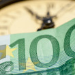 Stock Photo: Time is money with Euro