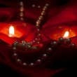 Pearls and heart candles — Stock Photo
