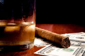 Cigar, whiskey and Dollars — Stock Photo