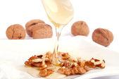 Honey and walnut — Stock Photo
