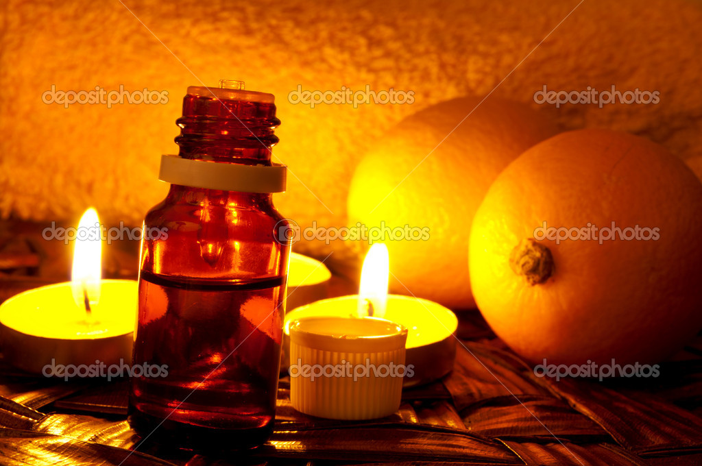 Bottle of lemon essential oil and candlelight  Stock Photo #9827845