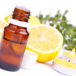 Essential oil and lemon - Stock Photo