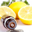 Foto Stock: Lemon essential oil