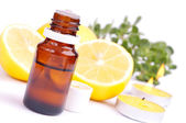 Essential oil and lemon — Stock Photo