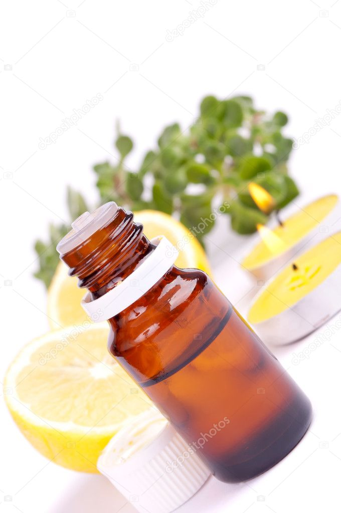 Lemon essential oil, fresh lemon and candles, isolated on white — Stockfoto #9920188