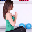 Girl fitness exercise and meditation — Stock Photo