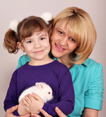 Mother and daughter with dwarf white bunny — Stock Photo