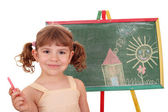 Little girl drawing on board — Foto de Stock