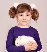 Little girl holding dwarf bunny pet — Stock Photo