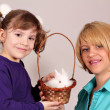 Mother and daughter with cute dwarf rabbit — Stock Photo
