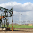 Oil field with pumpjack and oil worker — Stock Photo #10517843