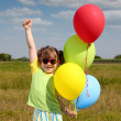 Stock Photo: Happy little girl with balloons