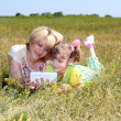 Mother and daughter are having fun with tablet — Stock Photo #10625392