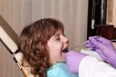 Little girl patient dental exam — Stock Photo