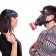Man with gas mask protects against tobacco smoke — Stock Photo #8362332