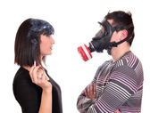 Man with gas mask protects against tobacco smoke — Stock Photo