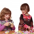Little girls play with toy blocks — Stock Photo