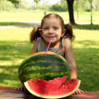 Beauty little girl with watermelon summer scene - Stock Photo