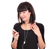 Beautiful girl with phone listening music — Стоковое фото