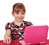 Beauty little girl with laptop — Stock Photo