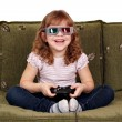 Happy little girl with 3d glasses play video game — Stock Photo