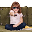 Happy little girl with 3d glasses watching tv — Stock Photo #9173997