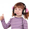 Little girl with headphones and thumb up - Stock Photo