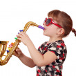 Little girl with sunglasses play music on saxophone - Stock Photo