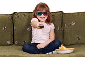 Happy little girl with 3d glasses watching tv — Stok fotoğraf