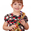 Happy little girl with saxophone posing - Stock Photo