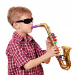 Boy with sunglasses play saxophone — Stock Photo #9885427