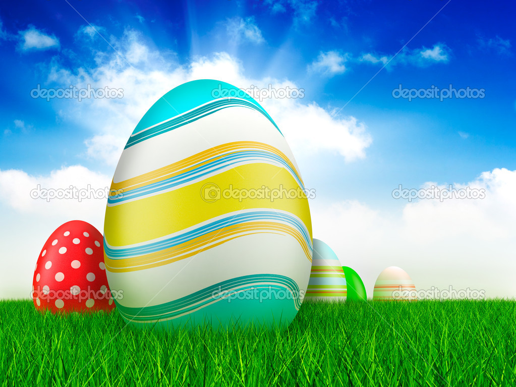 Easter eggs on grass and blue sky background  Stock Photo #8740136