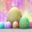Easter eggs on colored background — Stock Photo