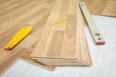 Laminate floor installation — 图库照片
