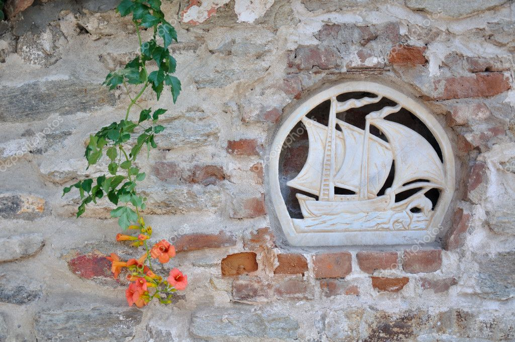 Ship detail on old wall in Kavala city - Greece — Stock Photo #8183486
