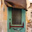 Old abandoned door — Stock Photo