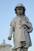 Statue of an sad little angel — Stock Photo
