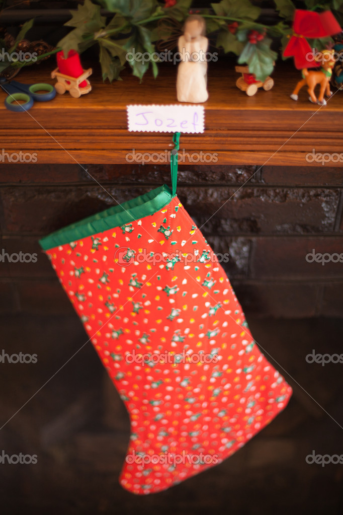 A childs Christmas stocking hanging from a mantle peice — Stok fotoğraf #8325808