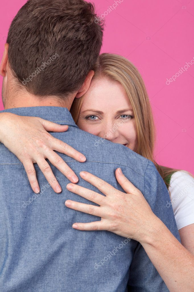 Beautiful blond Woman giving a man a big hug  Stock Photo #8650689