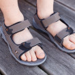 Stock Photo: Boy wearing flip flops