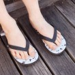 Boy wearing flip flops - Stock Photo