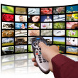 Digital television production concept, remote control TV. - Stock Photo